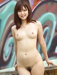 Cute and sexy Japanese av idol Tsukasa Aoi undresses outdoors to show her milky skin