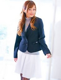 Beautiful Jun Natsukawa in a cute business suit and stockings