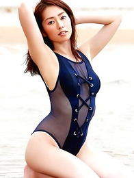 Momoko Tani with big tits plays in cradle on the beach